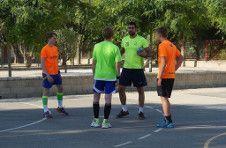 Monitor giving handball lessons in Alicante camp