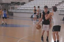 Thumbnail basketball training at a summer camp for students