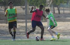 Thumbnail football students playing a match in Spain