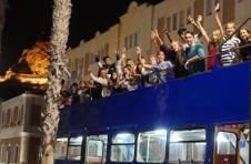 Thumbnail international students on an open-top bus tour