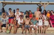 Thumbnail ISC students posing for a picture at the beach