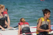 Thumbnail students learning to sail on the Spanish + Sailing camp
