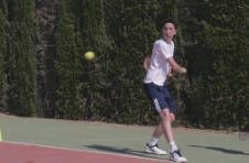 Thumbnail an ISC monitor and students practising their tennis backhands in Spain