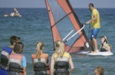 Thumbnail an ISC monitor teaching windsurfing techniques